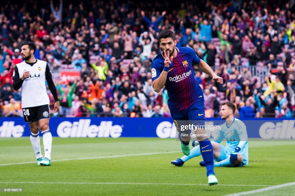 Luis Suarez of FC Barcelona celebrates scoring the opening goal during the La Liga match between Barcelona and Valencia at Camp Nou on April 14, 2018 in Barcelona, Spain.