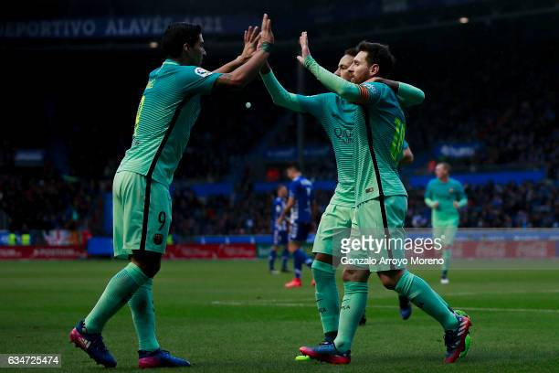 Luis Suarez of FC Barcelona celebrates scoring their opening goal with teammates Neymar JR and Lionel Messi during the La Liga match between...
