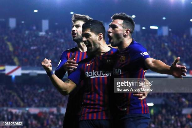 Luis Suarez of FC Barcelona celebrates scoring their third goal with teammates Gerard Pique and Munir El Haddadi during the La Liga match between...