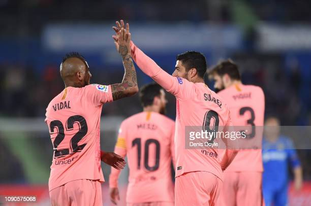Luis Suarez of FC Barcelona celebrates with Aleix Vidal after scoring his team's 2nd goal during the La Liga match between Getafe CF and FC Barcelona...