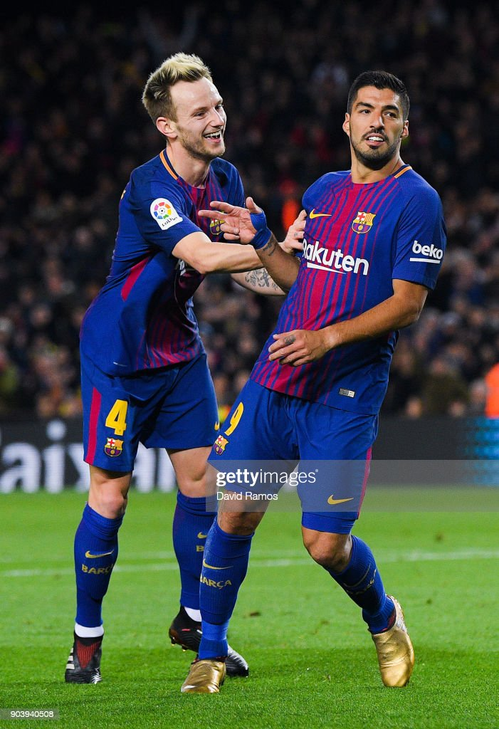 Luis Suarez (R) of FC Barcelona celebrates with his team mate Ivan Rakitic of FC Barcelona after scoring his team's fourth goal during the Copa del Rey round of 16 second leg match between FC Barcelona and Celta de Vigo at Camp Nou on January 11, 2018 in Barcelona, Spain.