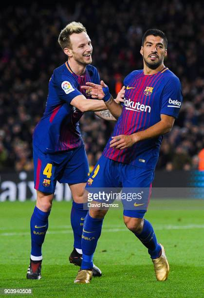 Luis Suarez of FC Barcelona celebrates with his team mate Ivan Rakitic of FC Barcelona after scoring his team's fourth goal during the Copa del Rey...