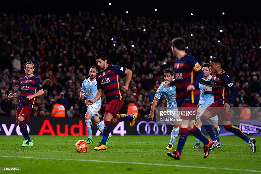 Luis Suarez of FC Barcelona celebrates with his team mate Lionel Messi of FC Barcelona after scoring his team's fourth goal from the penalty spot during the La Liga match between FC Barcelona and Celta Vigo at Camp Nou on February 14, 2016 in Barcelona, Spain. Messi took the penalty, tapping the ball softly forward for Suarez to score.