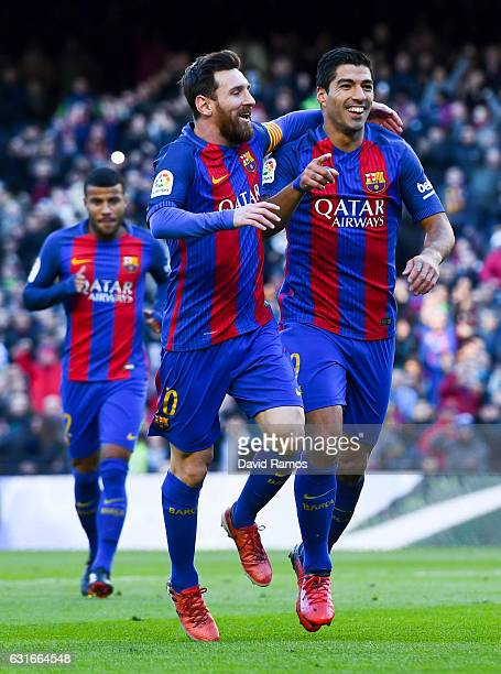 Luis Suarez of FC Barcelona celebrates with his team mate Lionel Messi after scoring his team's first goal during the La Liga match between FC...