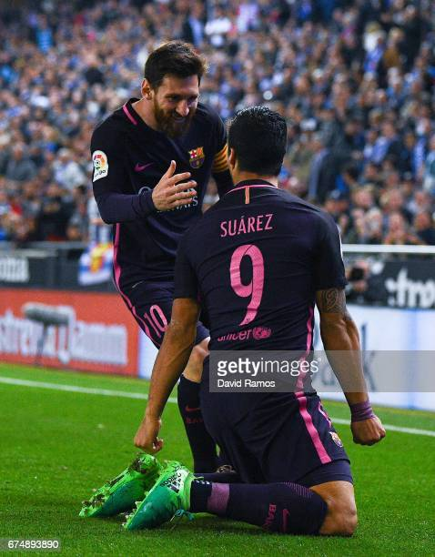 Luis Suarez of FC Barcelona celebrates with his team mate Lionel Messi after scoring the opening goal during the La Liga match between RCD Espanyol...