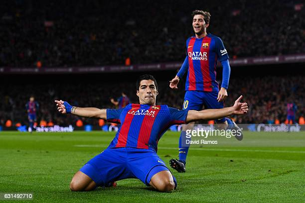 Luis Suarez of FC Barcelona celebrates with his team mate Sergi Roberto of FC Barcelona after scoring his team's first goal during the Copa del Rey...