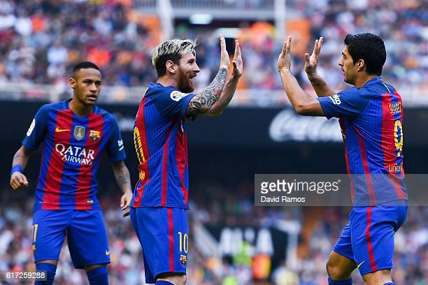 Luis Suarez of FC Barcelona celebrates with his team mates Neymar Jr and Lionel after scoring his team's second goal during the La Liga match between...