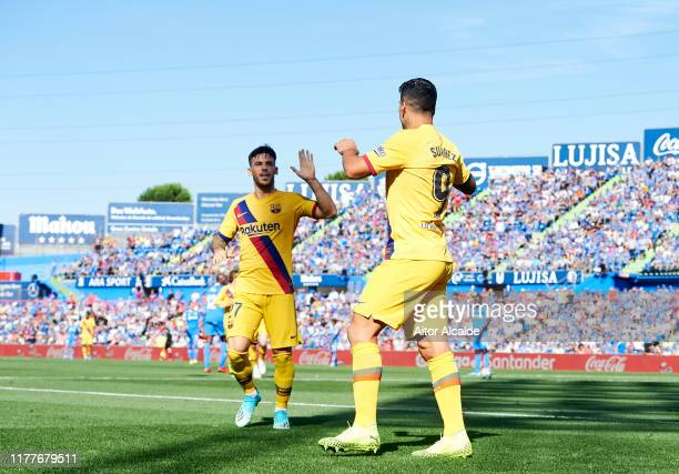 Luis Suarez of FC Barcelona celebrates with his teammate Carles Perez of FC Barcelona after scoring the opening goal during the Liga match between...