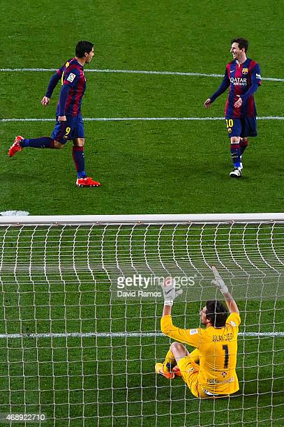 Luis Suarez of FC Barcelona celebrates with his teammate Lionel Messi of FC Barcelonas after scoring his team's second goal during the La Liga match...