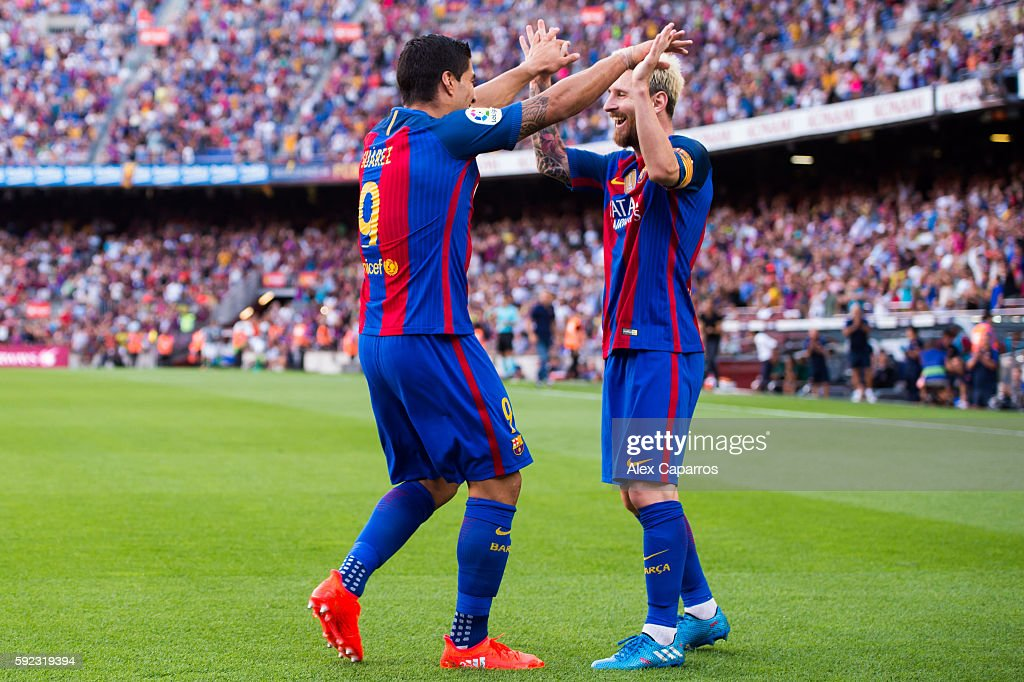 Luis Suarez (L) of FC Barcelona celebrates with his teammate Lionel Messi after scoring his team's fourth goal during the La Liga match between FC Barcelona and Real Betis Balompie at Camp Nou on August 20, 2016 in Barcelona, Spain.