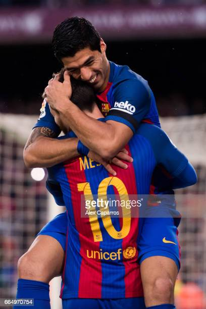 Luis Suarez of FC Barcelona celebrates with his teammate Lionel Messiafter scoring the opening goal during the La Liga match between FC Barcelona and...
