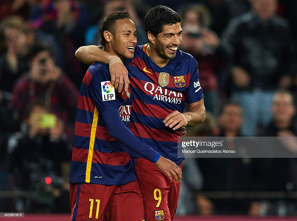 Luis Suarez (R) of FC Barcelona celebrates with his teammate Neymar of FC Barcelona after scoring his team's fourth goal during the La Liga match between FC Barcelona and Real Betis Balompie at Camp Nou on December 30, 2015 in Barcelona, Spain.