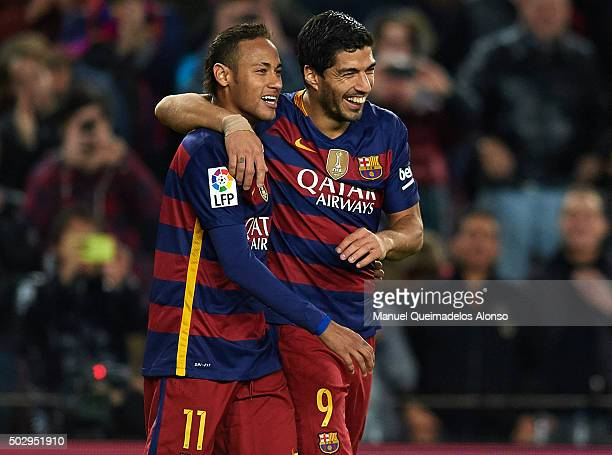 Luis Suarez of FC Barcelona celebrates with his teammate Neymar of FC Barcelona after scoring his team's fourth goal during the La Liga match between...