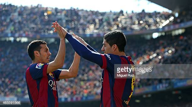 Luis Suarez of FC Barcelona celebrates with his teammate Pedro Rodriguez as he scored the first goal during the La Liga match between FC Barcelona...