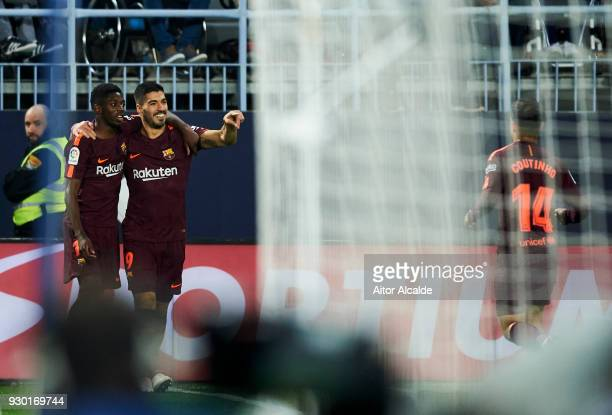 Luis Suarez of FC Barcelona celebrates with his teammate Samuel Umtiti of FC Barcelona after scoring the opening goal during the La Liga match...