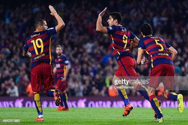 Luis Suarez of FC Barcelona celebrates with his teammate Sandro Ramirez of FC Barcelona after scoring his team's first goal during the La Liga match...