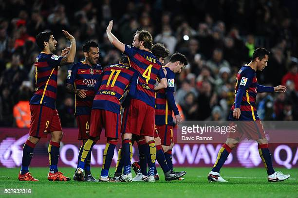 Luis Suarez of FC Barcelona celebrates with his teammates after scoring his team's fourth goal during the La Liga match between FC Barcelona and Real...