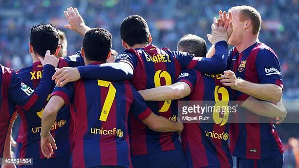 Luis Suarez of FC Barcelona celebrates with his teammates as he scored the first goal during the La Liga match between FC Barcelona and Rayo...