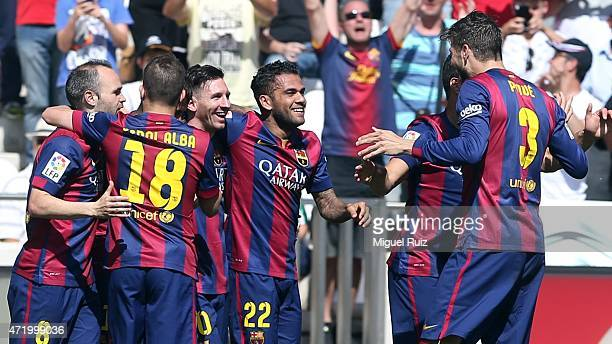 Luis Suarez of FC Barcelona celebrates with his teammates as he scored the second goal during the La Liga match between Cordoba CF and FC Barcelona...