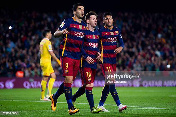 Luis Suarez of FC Barcelona celebrates with his teammates Lionel Messi and Neymar Santos Jr after scoring his team's second goal during the La Liga...