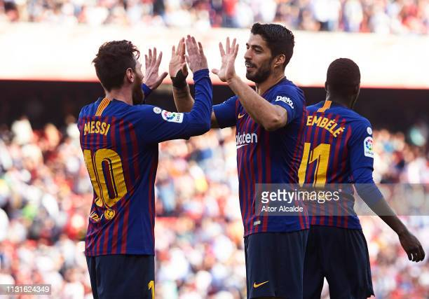 Luis Suarez of FC Barcelona celebrates with his teammates Lionel Messi of FC Barcelona after scoring his team's fourth goal during the La Liga match...