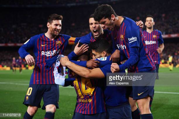 Luis Suarez of FC Barcelona celebrates with his teammates Lionel Messi Malcom Jordi Alba and Carles Alena after scoring the opening goal during the...