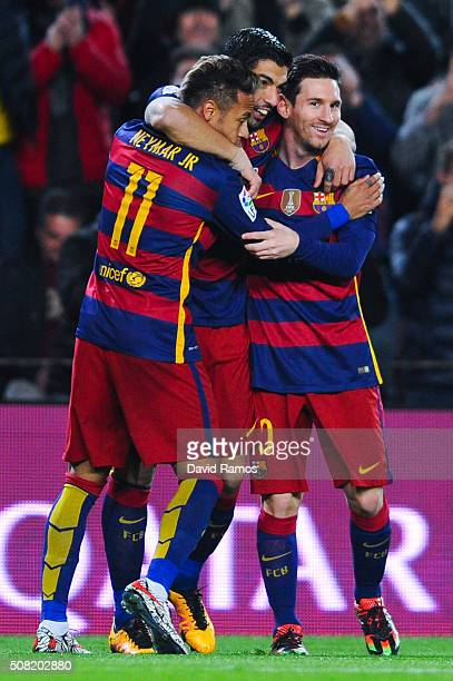 Luis Suarez of FC Barcelona celebrates with his teammates Neymar and Lionel Messi of FC Barcelona after scoring the opening goal during the Copa del...