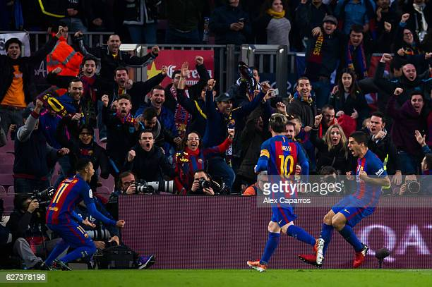 Luis Suarez of FC Barcelona celebrates with his teammates Neymar Santos Jr and Lionel Messi after scoring the opening goal during the La Liga match...