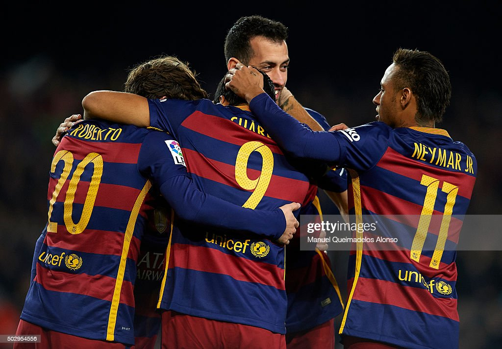 Luis Suarez (9) of FC Barcelona celebrates with his teammates Neymar, Sergi Roberto and Sergio Busquets after scoring his team's third goal during during the La Liga match between FC Barcelona and Real Betis Balompie at Camp Nou on December 30, 2015 in Barcelona, Spain.