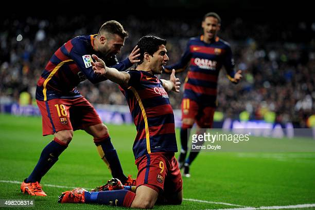 Luis Suarez of FC Barcelona celebrates with Jordi Alba after scoring his team's 4th goal during the La Liga match between Real Madrid and Barcelona...