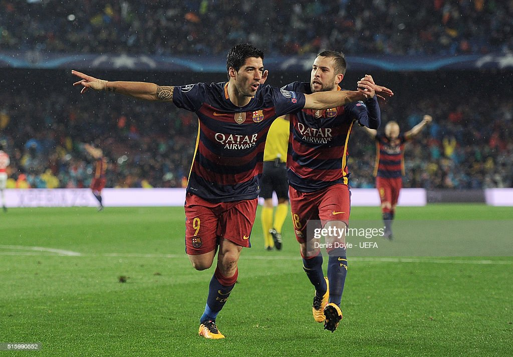 Luis Suarez of FC Barcelona celebrates with Jordi Alba after scoring his team's 2nd goal during the UEFA Champions League Round of 16 second leg match between FC Barcelona and Arsenal FC at Camp Nou stadium on March 16, 2016 in Barcelona, Spain.