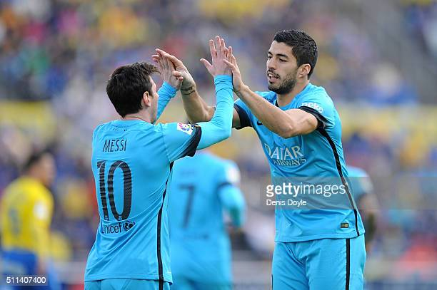 Luis Suarez of FC Barcelona celebrates with Lionel Messi after scoring his team's opening goal during the La Liga match between UD Las Palmas and FC...