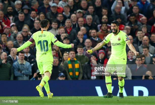 Luis Suarez of FC Barcelona celebrates with Lionel Messi after scoring the opening goal during the UEFA Champions League Quarter Final first leg...