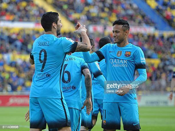 Luis Suarez of FC Barcelona celebrates with Neymar after scoring his team's opening goal during the La Liga match between UD Las Palmas and FC...