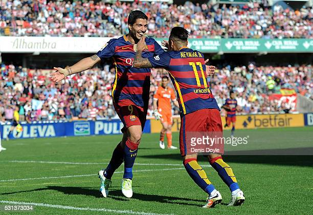 Luis Suarez of FC Barcelona celebrates with Neymar after scoring his third goal during the La Liga match between Granada CF and FC Barcelona at...