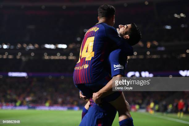 Luis Suarez of FC Barcelona celebrates with Philippe Coutinho after scoring their opening goal during the Spanish Copa del Rey Final match between...