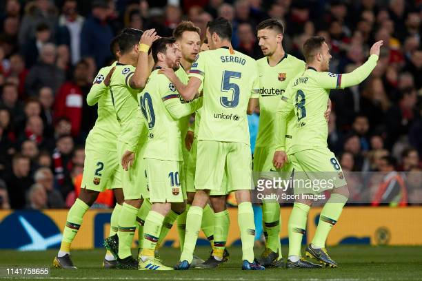 Luis Suarez of FC Barcelona celebrates with team mates after a Luke Shaw own goal puts Barcelona 01 up during the UEFA Champions League Quarter Final...