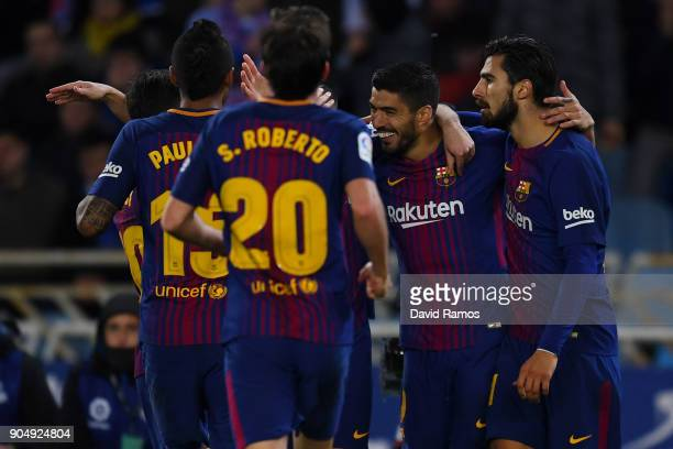 Luis Suarez of FC Barcelona celebrates with team mates after scoring his team's second goal during the La Liga match between Real Sociedad and FC...
