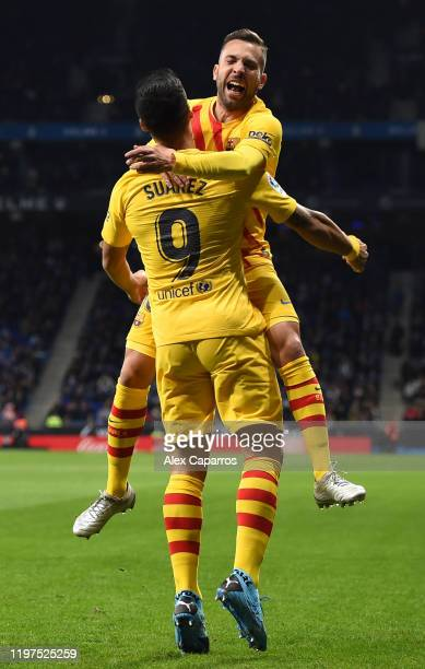 Luis Suarez of FC Barcelona celebrates with teammate Jordi Alba after scoring his team's first goal during the La Liga match between RCD Espanyol and...