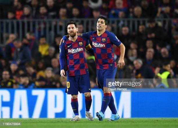 Luis Suarez of FC Barcelona celebrates with teammate Lionel Messi after scoring his team's first goal during the UEFA Champions League group F match...