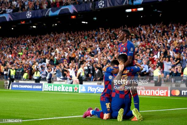 Luis Suarez of FC Barcelona celebrates with teammates Lionel Messi and Ousmane Dembele after scoring their team's second goal during the UEFA...
