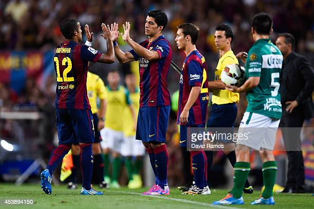 Luis Suarez of FC Barcelona comes onto the pitch during the Joan Gamper Trophy match between FC Barcelona and Club Leon at Camp Nou on August 18 2014...