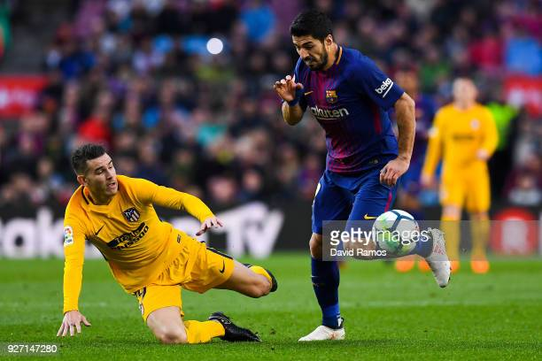 Luis Suarez of FC Barcelona competes for the ball with Lucas Hernandez of Club Atletico de Madrid during the La Liga match between Barcelona and...