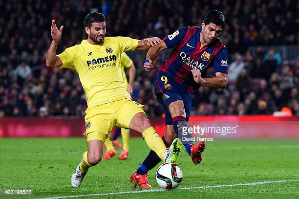 Luis Suarez of FC Barcelona competes for the ball with Mateo Musacchio of Villarreal CF during the Copa del Rey SemiFinal first leg match between FC...