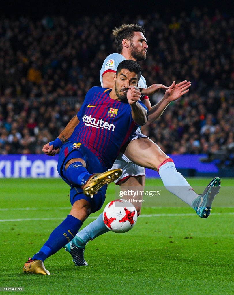 Luis Suarez of FC Barcelona competes for the ball with Sergi Gomez of RC Celta de Vigo during the Copa del Rey round of 16 second leg match between FC Barcelona and Celta de Vigo at Camp Nou on January 11, 2018 in Barcelona, Spain.