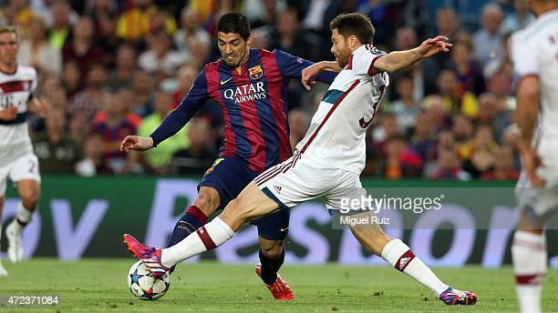 Luis Suarez of FC Barcelona competes for the ball with Xabi Alonso of Bayern Muenchen during the UEFA Champions League Match between FC Barcelona and...
