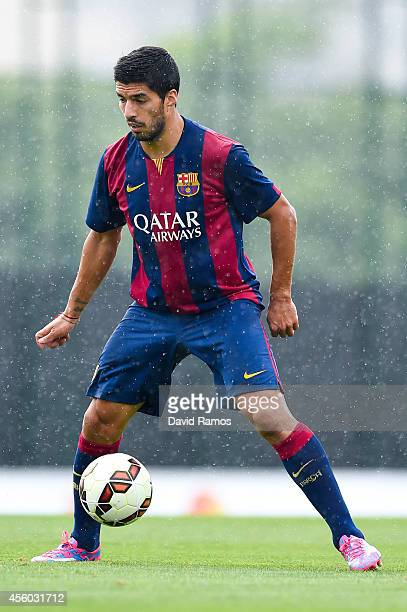 Luis Suarez of FC Barcelona controls the ball during a friendly match between FC Barcelona B and Indonesia U19 at Ciutat Esportiva on September 24...