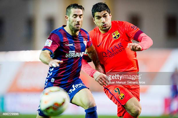Luis Suarez of FC Barcelona duels for the ball with Manuel Castellano ÔLillo' of SD Eibar during the La Liga match between SD Eibar and FC Barcelona...
