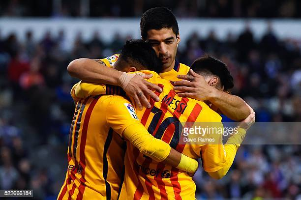 Luis Suarez of FC Barcelona embraces his team mates Neymar and Lionel Messi of FC Barcelona after Neymar scores his team's eighth goal during the La...