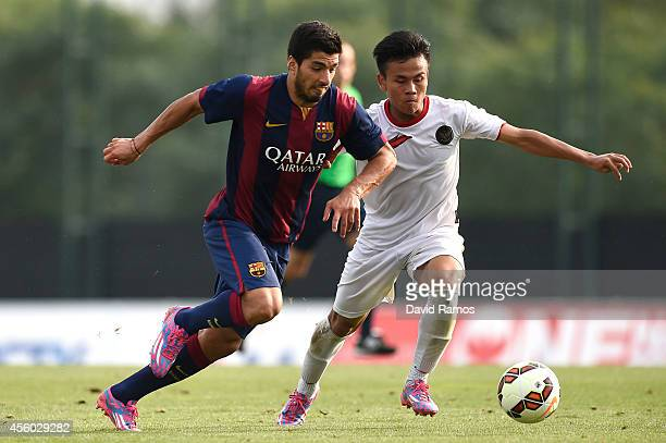 Luis Suarez of FC Barcelona fights for the ball against Putu Gede of Indonesia U19 match between FC Barcelona B and Indonesia U19 at Ciutat Esportiva...